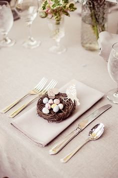 Little nests filled with chocolate eggs placed at each setting.