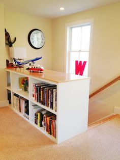 2-sided bookshelf in place of a railing at the top of the stairs in my home office. (click for higher res)