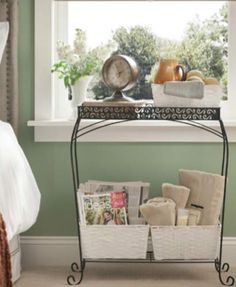 Create a holiday guest stand with a plant table and three baskets.