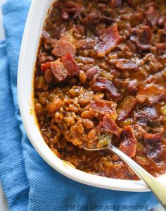 The Best Baked Beans: ground beef, onion, bell pepper, cans of pork and beans, barbecue sauce, ketchup, spicy brown mustard, Worcestershire sauce, soy sauce, brown sugar, bacon