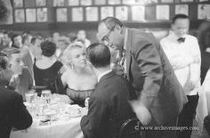Marilyn dining at Sardi's restaurant in NYC, 1954. Photo by Milton Greene.