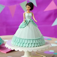 Doll in Blue Dress Cake - Decorate a doll cake perfect for a little girl's birthday party! Easily make the ball gown shape with the Wonder Mold pan. The pretty scallops at the hem are made using dots of icing which are pulled out with a spatula. Cake Decorating Techniques, Cake Decorating Tips, Doll Cake Designs, Dress Designs, Dolly Varden Cake, Doll Birthday Cake, Cake Kit, Cake Delivery, Beautiful Cakes