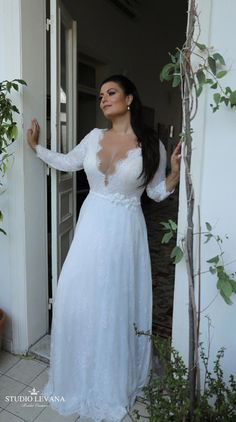 Plus size seductive gentle French lace wedding gown with long sleeves. Studio Levana Plus si Informal Wedding Dresses, Plus Size Wedding Gowns, Western Wedding Dresses, Best Wedding Dresses, Designer Wedding Dresses, Bridal Dresses, Bridesmaid Dresses, Wedding Dress Trumpet, Full Figure Wedding Dress