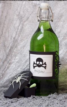 Turn ordinary cider into a poison potion with a quick and cute die cut label - an easy die cut coffin box holds creepy crawly treats!