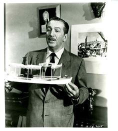 Walt Disney shows off a model of the Jungle Cruise's Congo Queen for a television show in 1955.