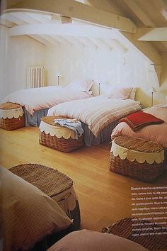 Bunk attic *cozy and dreamy space... Love the storage baskets at the foot of each bed