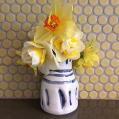 That day I spent planting daffodil bulbs in the fall, wondering why I had ordered SO MANY, then the days after spent cursing at squirrels digging them up, PAID OFF. And the smell!  I love a bud vase with a narrow neck. You can get away with less flowers.