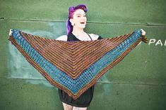 Distinction is a top-down triangle shawl that knits up quickly, and is meant to drape loosely.