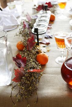 Thanksgiving table - love the oranges!