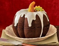 Pumpkin Spice Cake with Maple Glaze. Bake in two Bundt Pans and stack on top of each other for Pumpkin Shape. Cute idea!