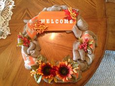 My newest creation!! Fall burlap wreath!! Love the colors, flowers, leaves, and chevron burlap ribbon!!! Fall is my favorite time of year!!!