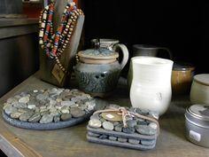 Just a little sneak peak of things at the Studio.. Trivets, coasters, & pottery. www.barkingdogstudio.ca
