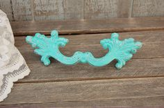 """Aqua French provincial drawer pulls...6.75 wide, 2.25 tall, .8"""" deep w/ 4 1/8 screw centers. $9.00 each, plus $6 shipping."""