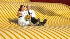 Couple weds on giant slide at Big E in West Springfield The Big E, West Springfield, Dress Shirt And Tie, Burlap Bags, Groom Wear, Wedding Couples, Bride, Wedding Bride, The Bride