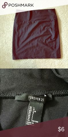 Black Body Con Skirt Forever 21 tight black mini skirt. Size large. 16 inches from top to bottom and side to side. Never worn. Forever 21 Skirts Mini