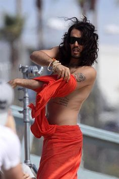 Russell Brand with Aldous Snow tatoos.