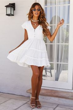 We're absolutely OBSESSED with this little number at Hello Molly HQ! Our Something Going On Dress features a button up front, V neckline, short capped sleeves and a subtle tiered detail across the skirt. Grad Dresses, Cute Dresses, Casual Dresses, Cute Outfits, Short Sleeve Dresses, Summer Dresses, White Dresses For Graduation, High School Graduation Dresses, White Dress Casual