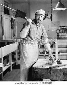 Butcher chopping meat with cleaver by Everett Collection, via Shutterstock