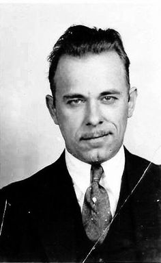 "Practicing the infamous ""Smirk at the Law"". John Dillinger seeking public office. Candidate for Attorney General. Just gotta get the smirk down a bit more there John! Practice - practice - practice!"