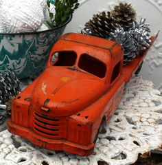 vintage truck Christmas display. I have an old wooden red one that I also put pine cones in & place under the tree with other old toys.