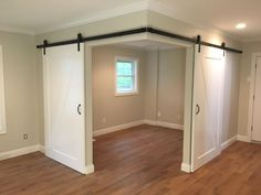 Created a versatile space in an open room with barn doors - Haus und Garten - Basement Bedrooms Basement Makeover, Basement Renovations, Home Renovation, Home Remodeling, Basement Storage, Small Basement Remodel, Closet Storage, Bedroom Storage, Closet Organization