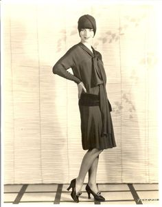 """A well dressed woman, even though her purse is painfully empty, can conquer the world."" -- Louise Brooks"