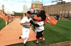 2000: Opening Day at Oriole Park at Camden Yard. Cal Ripken Jr. and the Oriole Bird during the opening introductions. (Gene Sweeney Jr./Baltimore Sun)