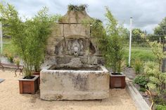stone wall with water feature french - Google Search
