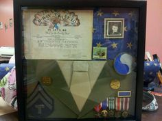 In my house we have a military shadow box from my father. He is a veteran that put some of his greatest years into the service. The box is just a simple way to remember what he did for us.  http://www.usshadows.net