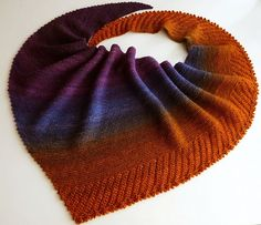 Cameo shawl. Can be knit in any weight of yarn. Garter stitch with striped and lace sections added for visual interest. Picot edge is knit as you go.