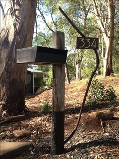 Recycled steel and timber letterbox/mailbox. Australian bush landscape.