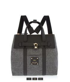 <p>The Jetsetter Mini Convertible Canvas Backpack takes fashionable versatility to the next level. Adorned with a Saffiano leather trim, rich satin lining, and a lock charm front detail, this compact luxury handbag offers endless pocket options and multiple carrying possibilities.</p>