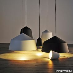 Simple shapes in matte black and white reveal a warm glow as light bounces off the antique gold interior, Circus Pendant Light. #innermost #pendantlight #corinnawarm Available at metropolitandecor.com  http://www.metropolitandecor.com/Circus-15-Pendant-Light-Innermost_p_2599.html