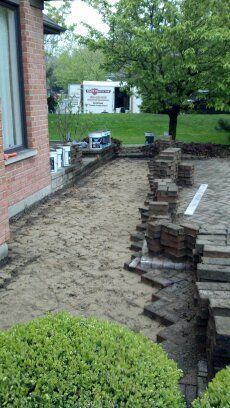 Half of the patio lifted and ready for additional gravel and sand and resetting. | www.paverprotector.com #paverprotector
