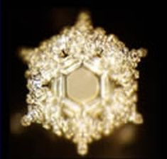 shape of water crystal after the words of love & gratitude spoken/tapped on to it.Work on water crystals done by Masaru Emoto