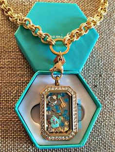 Origami Gold Heritage Locket featuring Swarovski® crystals! #origamiowl #jewelry Order at http://www.tangledinlockets.origamiowl.com Want to learn how to become a designer contact me today at ootangledinlockets@gmail.com