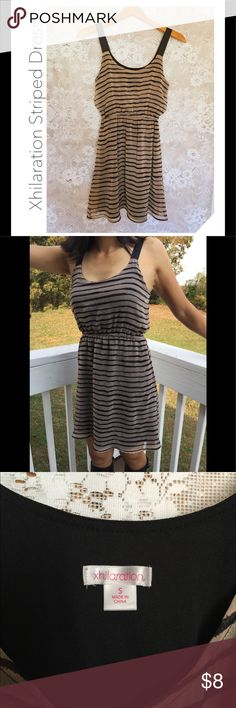 Xhilaration striped dress Xhilaration striped dress. Adorable for summer and very leightweight, only worn once or twice.Comes from a pet free and smoking free home. Xhilaration Dresses