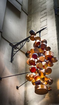 Copper pots artistically recreated into an outdoor light fixture at Chez Clement,  a restaurant in Paris.....