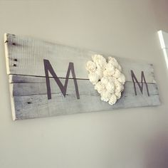 """Choose your own color!  White washed pallet wood with the word """"Mom"""" is completed by adding our beautiful sola wood flowers.  This design makes a wonderful gift for someone who is in need of daily inspiration."""