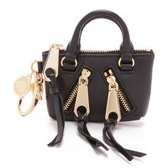 Rebecca Minkoff Moto Satchel Coin Purse ($66) ❤ liked on Polyvore featuring bags, wallets, black, coin pouch, leather change purse, leather key ring, coin purse и leather coin pouch