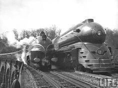 "British train the ""Coronation Scot"" running along side American locomotive during 1939 trip between Baltimore, Maryland and Washington. Photographer: Hansel Mieth."