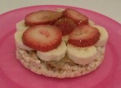 Rice cake , almond butter , banana, strawberry,  dash of cinnamon and drizzle honey/agave nectar.  Perfect snack for the Advocare 24 Day Challenge.  https://www.advocare.com/140236360/Store/24Wizard/
