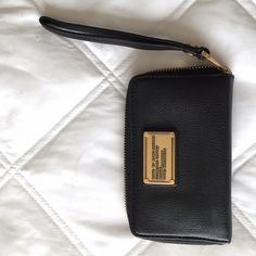 "Marc by Marc Jacobs Classic Q Wingman Phone Wallet Great condition, small scuff marks on outer leather. About 5.5"" wide, 3.5"" tall. Inside is designed with card clots, 1 zipper pocket and 3 open pockets. Cell phone pocket fits iPhone 5, though IPhone 6 fits in center. Marc by Marc Jacobs Bags Clutches & Wristlets"