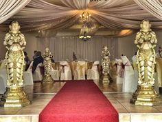 Monte Vista Venue traditional Hindu statues with a red carpet at the entrance of a gold and maroon Hindu wedding