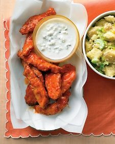 Transform a familiar (and irresistible) bar snack into dinner by serving spicy chicken and a cool dipping sauce with potato salad for a side. We replaced wings with skinless tenders so our buffalo chicken is easier to eat -- and lower in calories. You could also cut boneless breasts into strips, and save money.