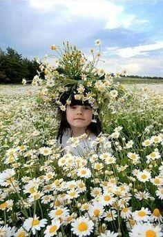"Little girl in the ""ocean"" of chamomiles."