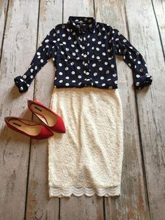 I'm in love with everything about this outfit: the red pumps, the polka dot blouse and the lacy skirt. Love it.