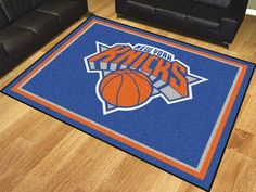 Show your team pride and add style to your tailgating party with Sports Licensing Solutions area rugs. nylon carpet and non-skid Duragon latex backing. Officially licensed and chromojet printed in true team colors. Basketball Tricks, Indoor Basketball, Basketball Teams, New York Knicks Logo, Nba New York, Plush Area Rugs, 8x10 Area Rugs, Basketball Training Equipment, Nylon Carpet