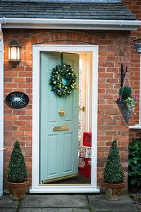 Wreath by Winter Flowers on a Composite Traditional Everest Door