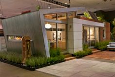 This eco-friendly prefabricated house, designed by architect Jonathan Davis, with interiors by sustainability expert Zem Joaquin, was featured at the The Dwell on Design Expo in Los Angeles. The prefab house, consisting of 520 square feet, was sold on eBay with proceeds going to Global Green USA.